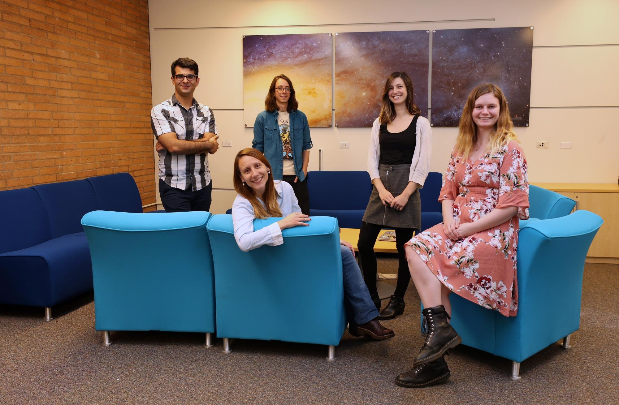 Laura Sales (seated, left) with her research group of former and current students, including Jessica Doppel (seated, right).