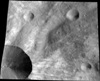 Carbon-Rich Asteroids Contribute to Dark Material on Giant Asteroid Vesta